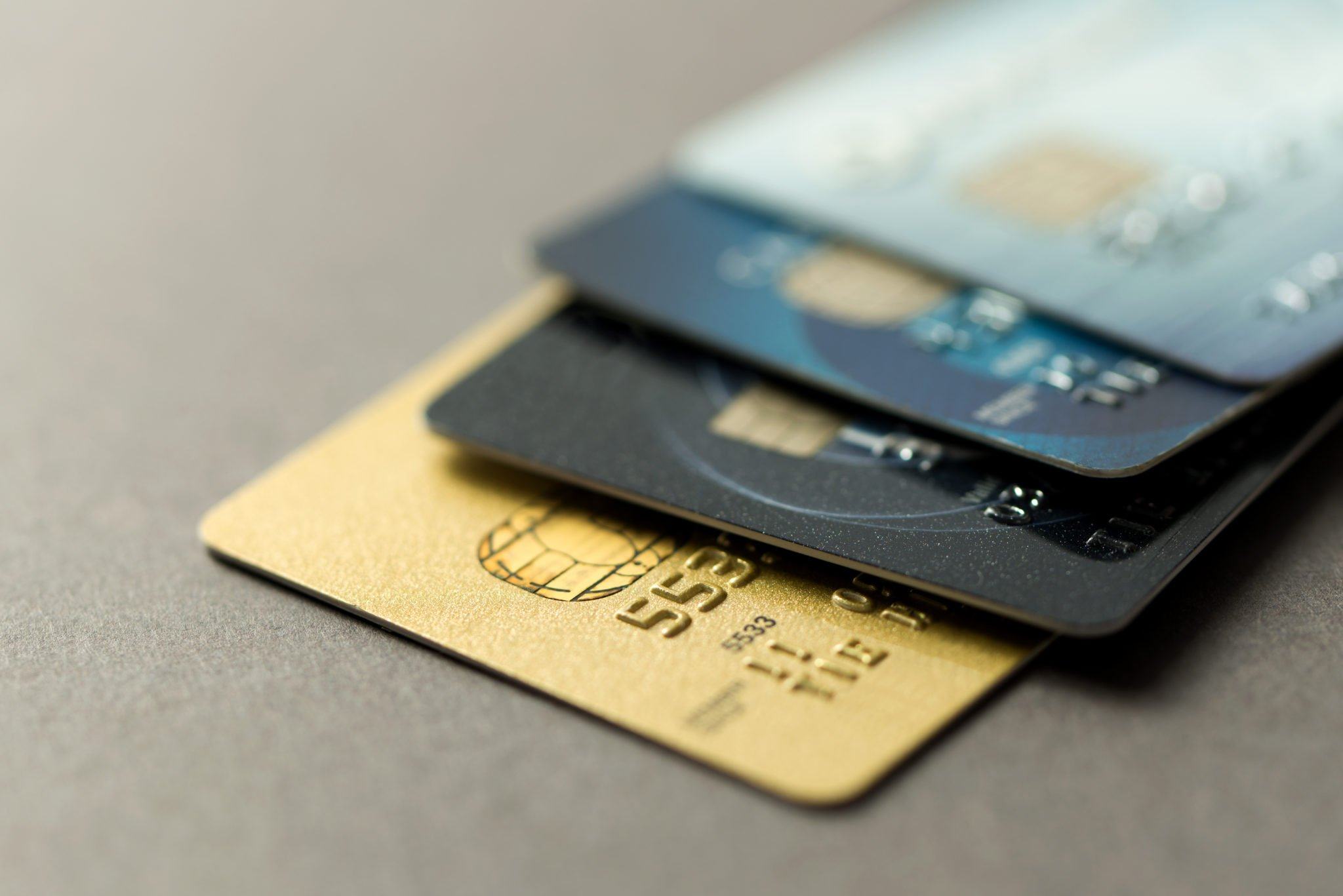 Close up of credit cards over grey background