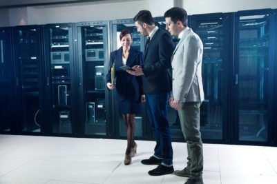 Business people in data-center checking systems.